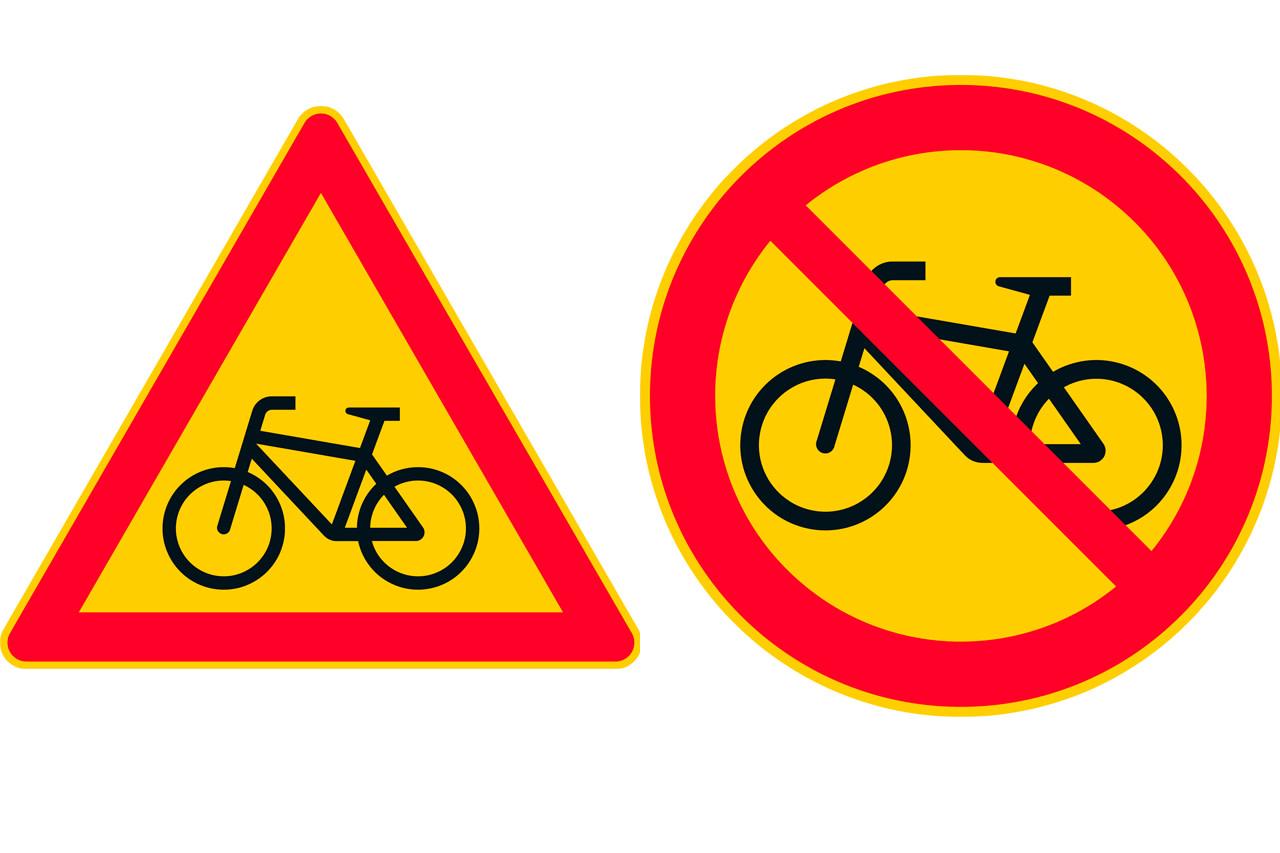 Polkupyörä kolmion sisällä, polkupyörä ympyrän m,uotoisen merkin sisällä, pyörän yli menee viiva.